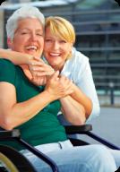 portrait of a woman hugging an elder
