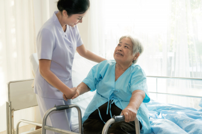 nurse supporting elderly patient