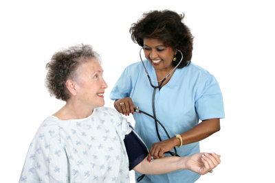 nurse checking blood pressure of her patient